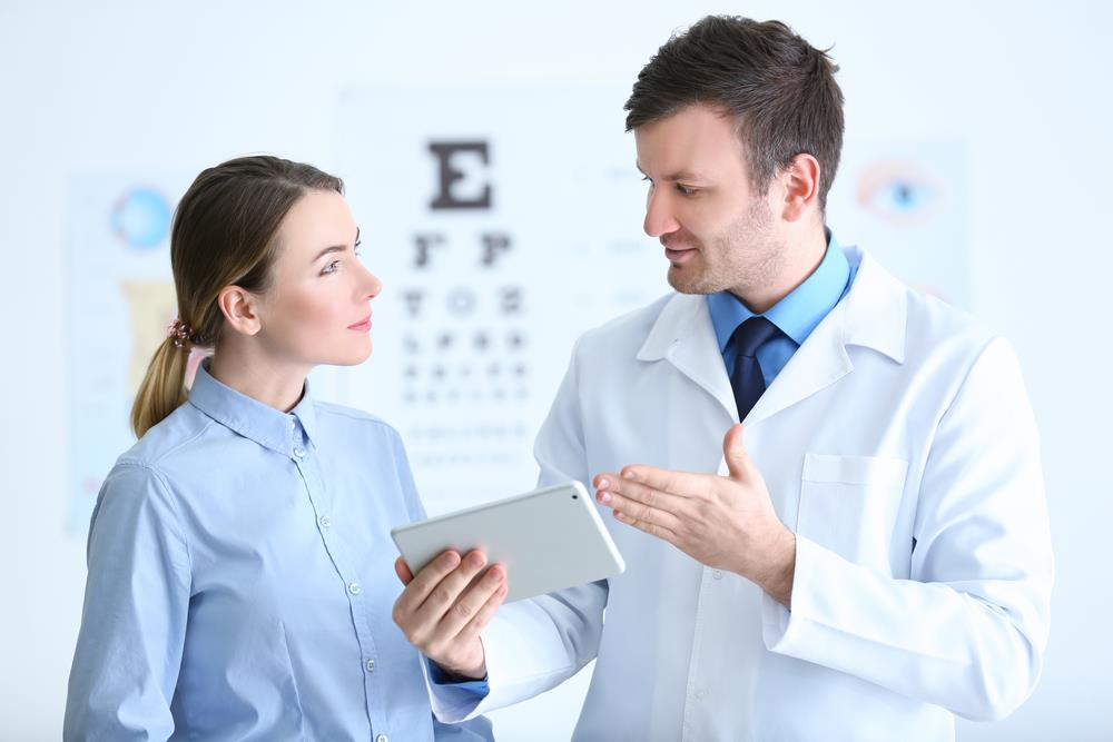 an optometrist assisting a patient in his practice