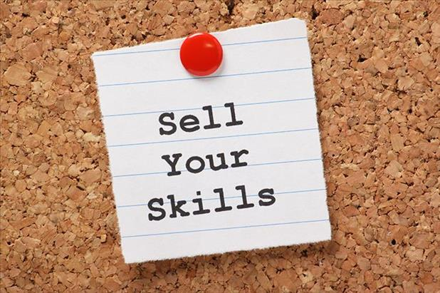 "Sheet of paper reading ""sell your skills"" on a bulletin board"