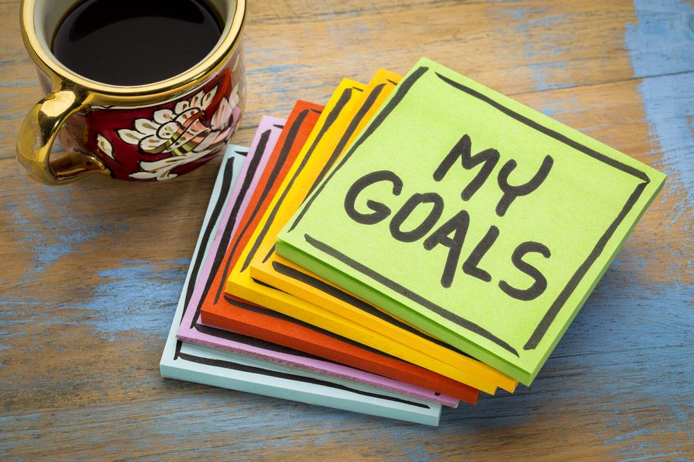 Stack of colorful sticky notes sitting on desk with 'My Goals' written in black marker