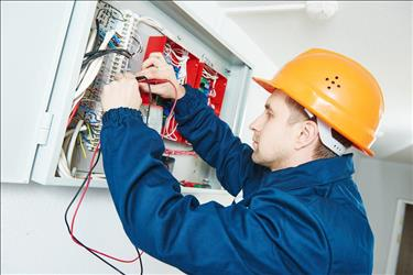 electrical and electronics installer working on a wiring system