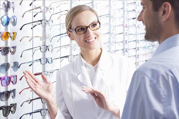 optician assisting a customer with selecting frames