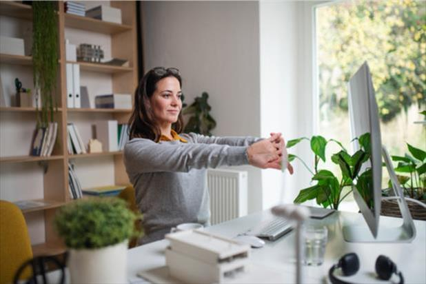 woman at desk with plants