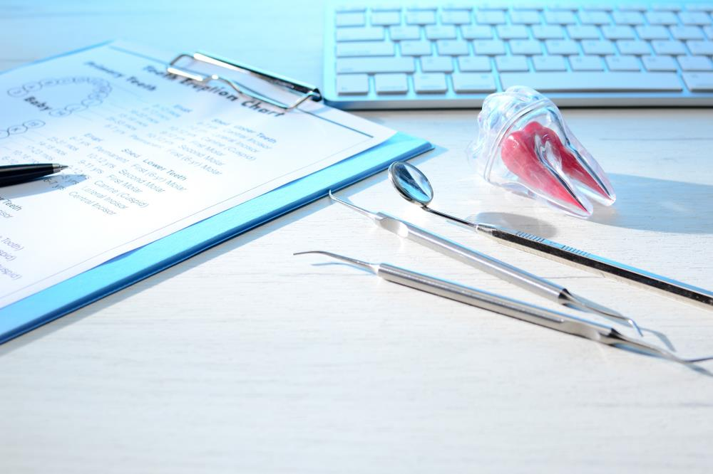 community dental health coordinator's desk with a chart, tools, etc. on it