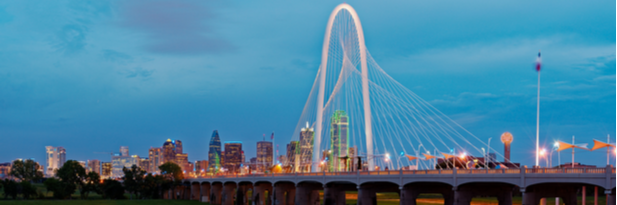 Photograph of the Dallas skyline at dusk