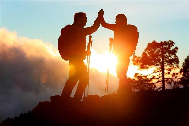 two hikers committed to reaching the top