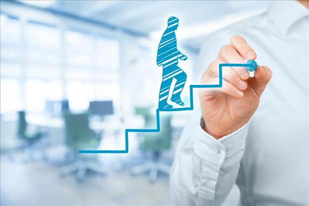 male job seeker drawing himself walking up a flight of steps to represent career growth