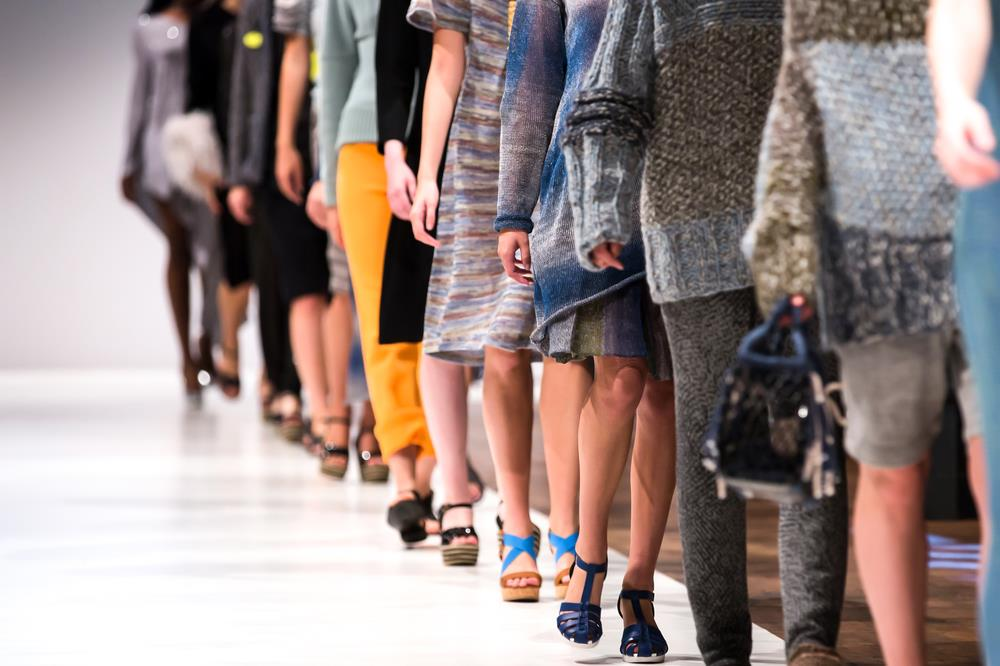 Fashion models walking down runway
