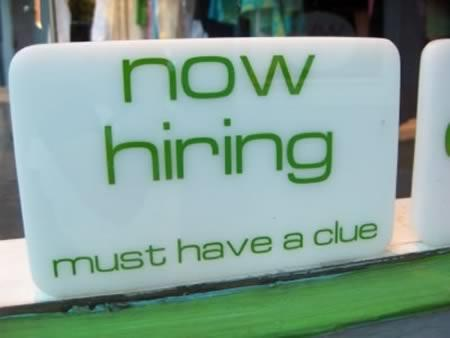 "Sign reading ""now hiring - must have a clue"""