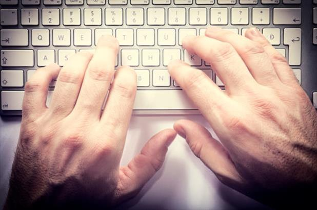 hands typing email used in salary negotiation