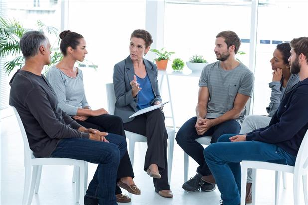 mental health professional leading a group therapy session