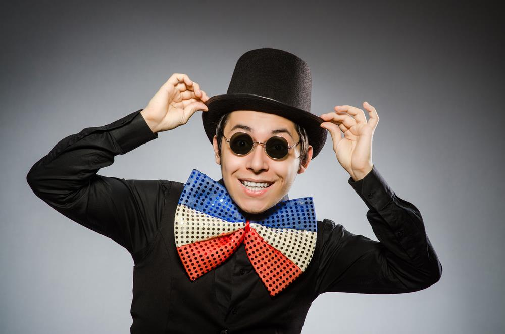 Silly job seeker is trying too hard to have a memorable brand, wearing a tacky bow tie, sunglasses, and a top hat.