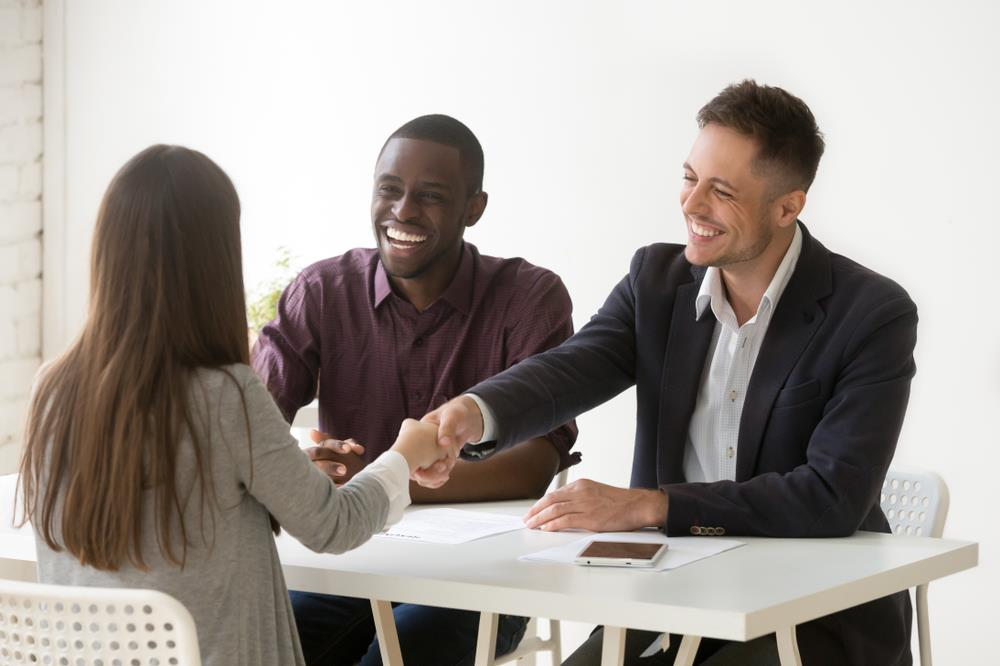 Intern Shakes Hand with Prospective Employer