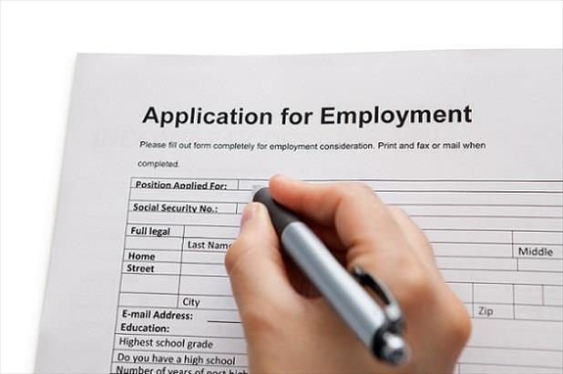 Job seeker filling out an employment application