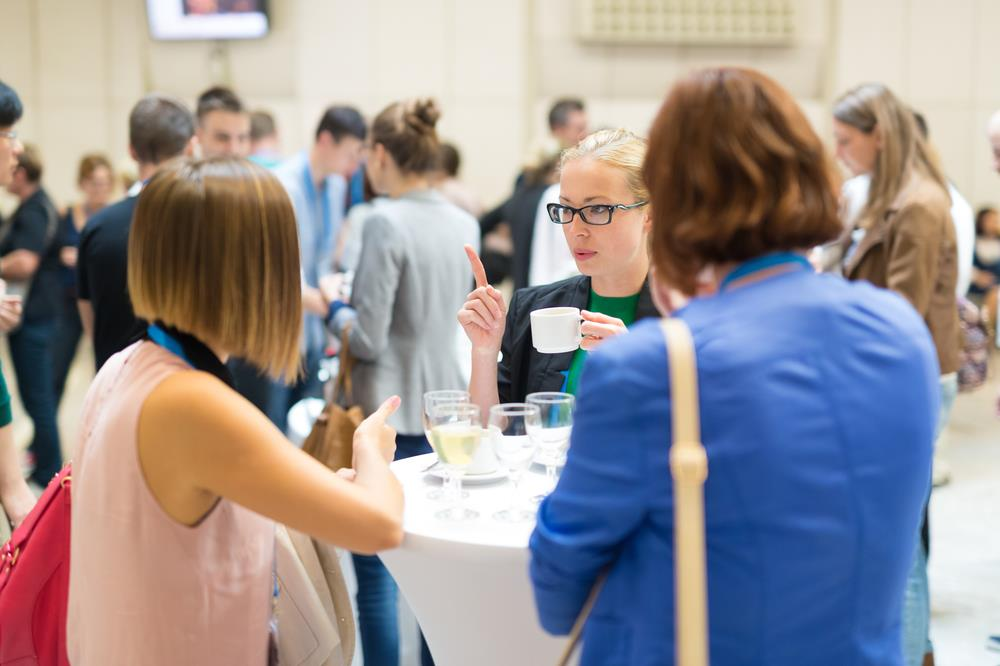 optometry professionals networking at a conference