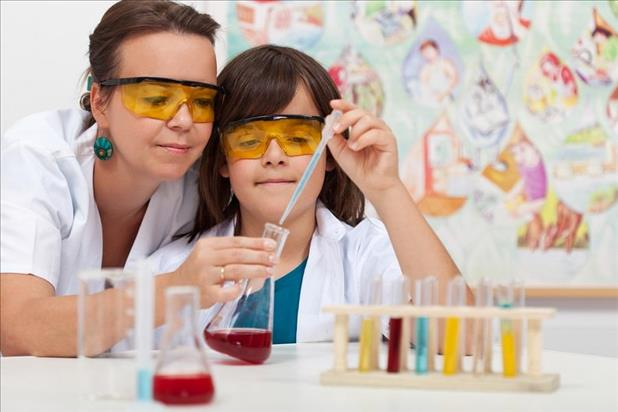 chemist volunteering in a classroom with young student