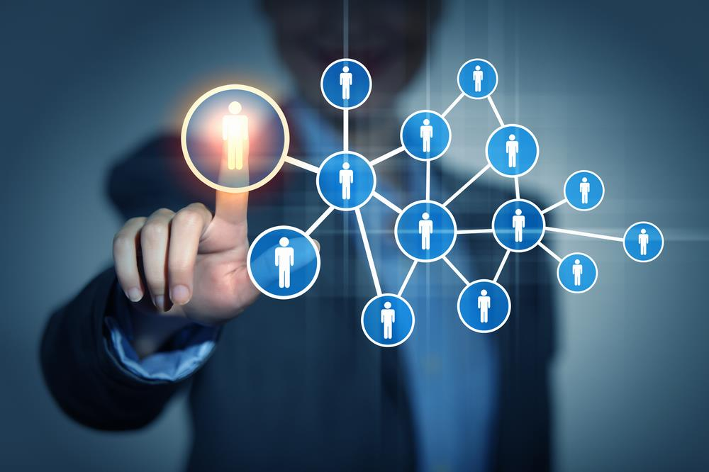 Person touching networking grid