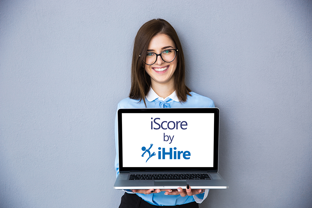 Woman holding laptop with iScore icon