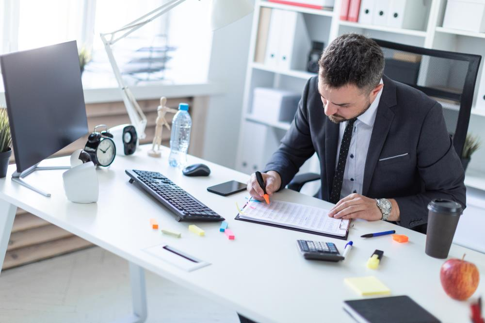 insurance agent reviewing client data at his desk