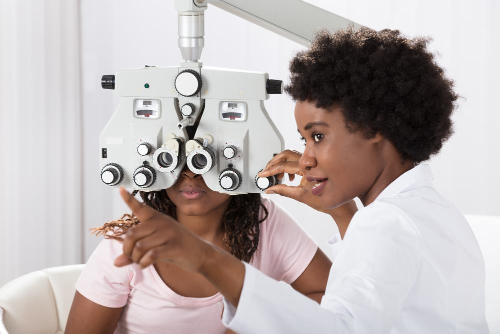 ophthalmic technician conducting a test on a patient