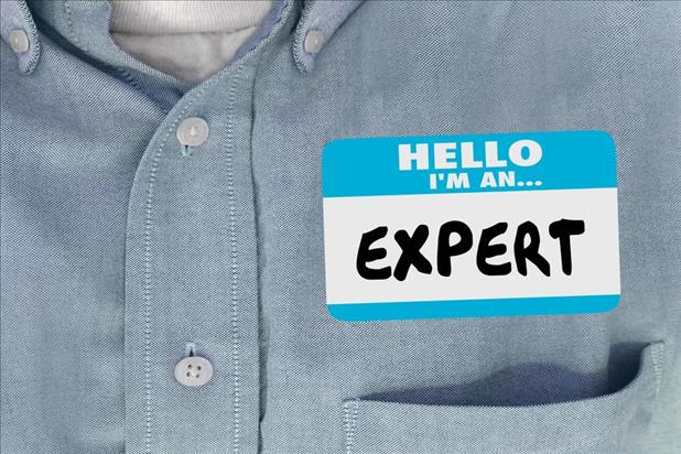 person with expert on their name tag