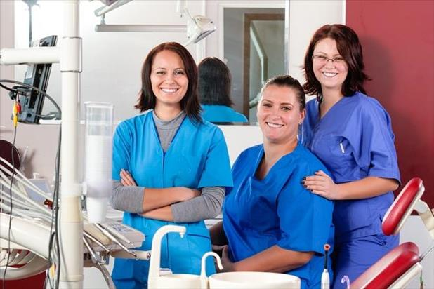 Group of smiling dental assistants