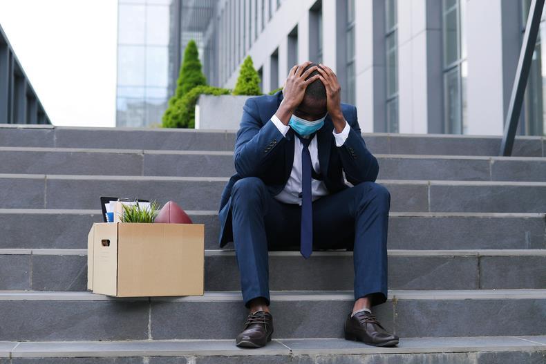 Unemployed man on steps