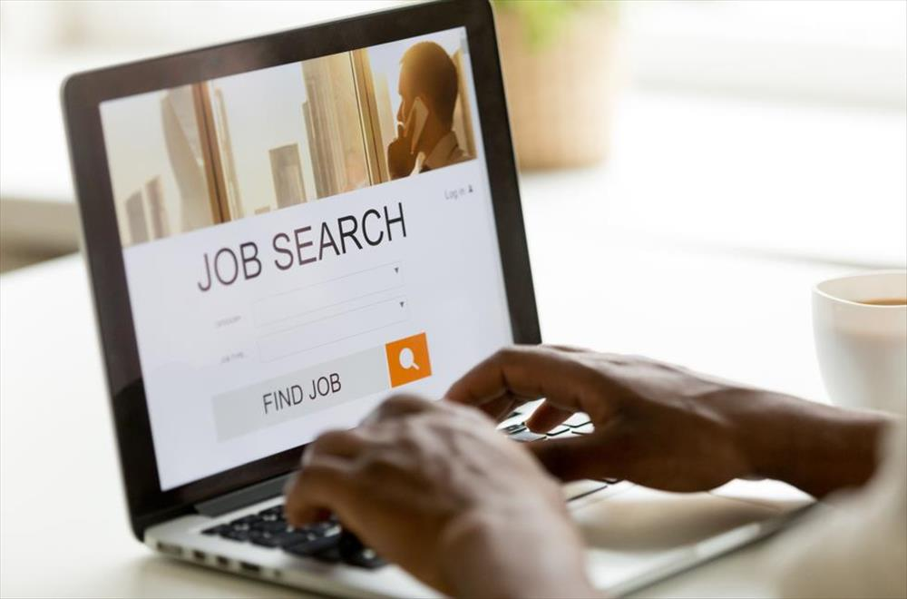 Job search on laptop
