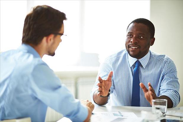 Hiring manager and prospective employee negotiating salary