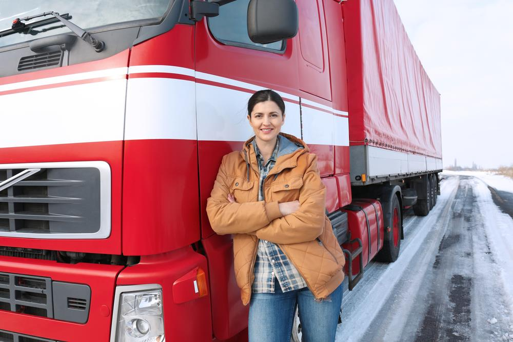 truck driver standing in front of her truck