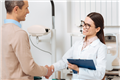 Practice owner shaking hands with newly hired associate optometrist