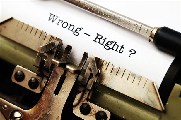 "Paper in typewriter reading ""wrong - right?"""