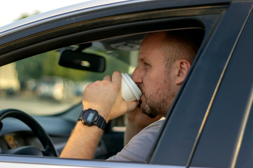 Man drinking coffee on his way to work