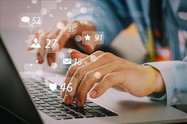 Job seeker using social media on laptop