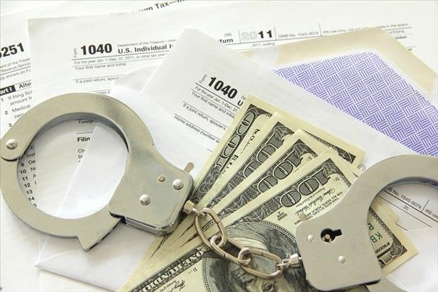 Image of handcuffs, cash, and tax forms