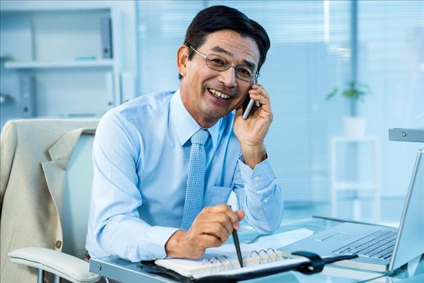 Businessman smiling while talking on the phone