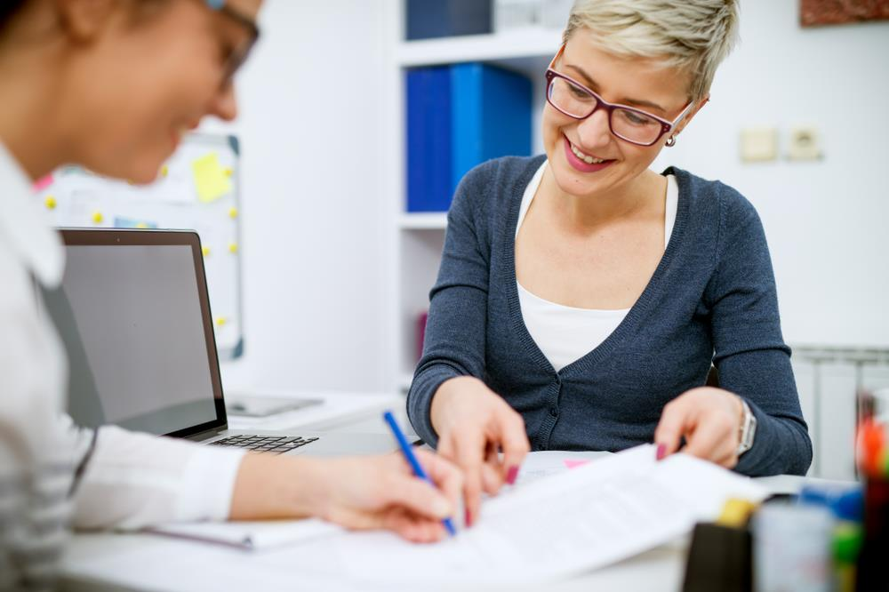 Career advisor helping transitioning employee at an outplacement cetner