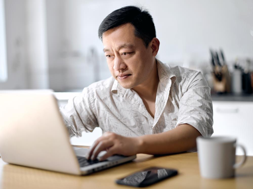 Man searching for job at home using an online job search platform
