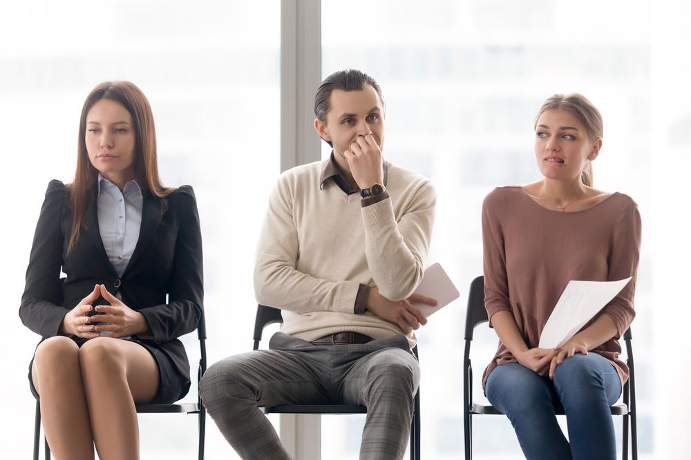 group of nervous job seekers unsure about the strength of their resumes