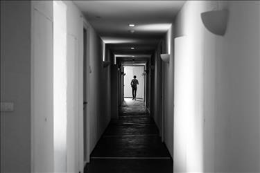 Ghostly apparition at the end of a long hallway