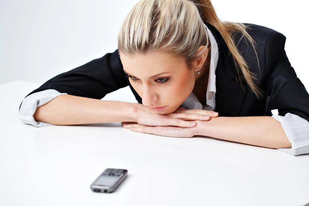 Recruiter waiting anxiously by the phone for candidates to call her back