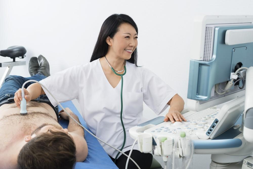 diagnostic medical sonographer performing an ultrasound exam on a patient