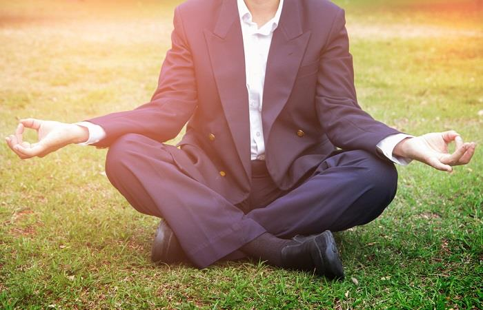 Calm businessman meditating
