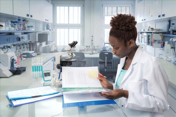medical laboratory technician reviewing data in the lab