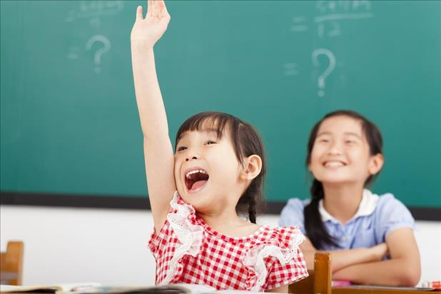 eager student raising her hand to ask a question
