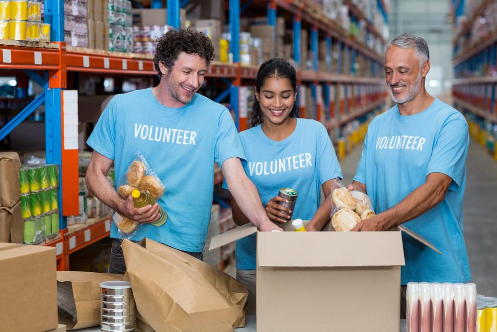 group of volunteers stocking warehouse shelves