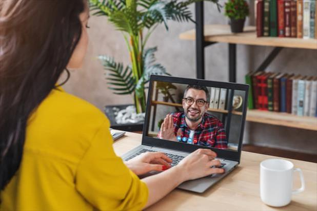 woman interviewing man on screen