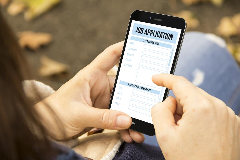 Candidate filling out job application on their smartphone
