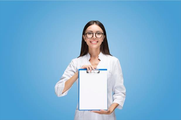woman holding up a checklist