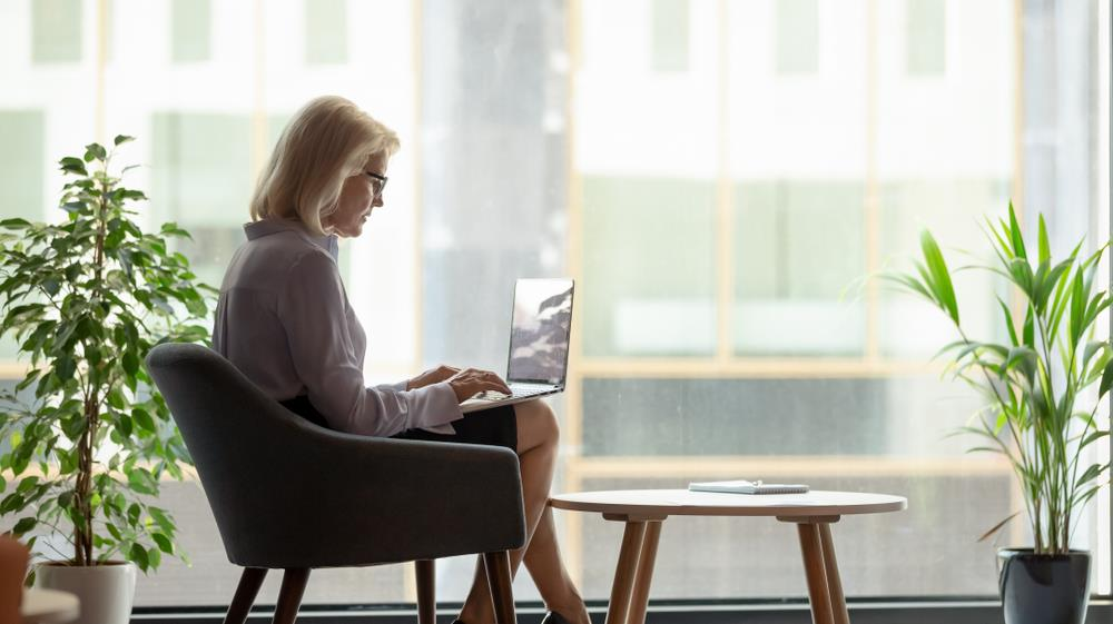 Woman on laptop preparing for her career change