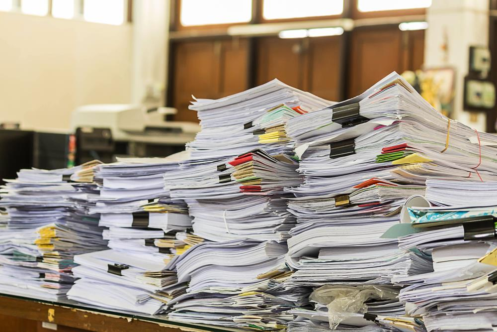 large pile of resumes and employment applications